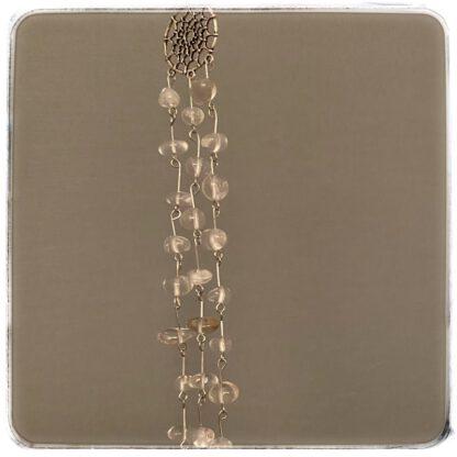 Valon kutsu, vuorikristalli helmiä nauhoina kiinnitetty metalliseen, korumaiseen unisieppariin